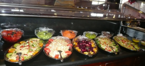 several plates of assorded cold salada