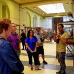 male guide giving information in Cairo Museum of Antiquities