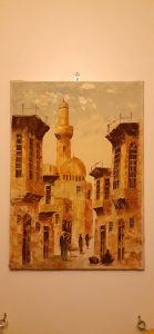 Oil painting mostly in shades of yellow of a street in Old Cairo